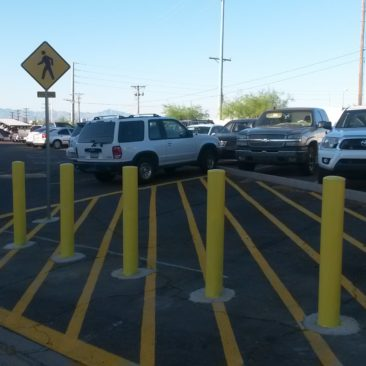 Bollards and signage to protect no parkiing exclusion zomnes