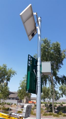 Solar panel powered sign mounting to the post.
