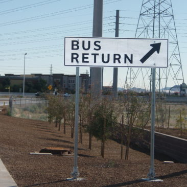 Roadway signage at a park and ride