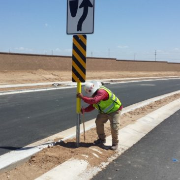 Median signage being installed and checked